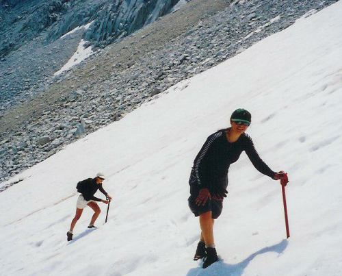 Maria and Tasha slog their way up the snow to the Royce - Merriam saddle.