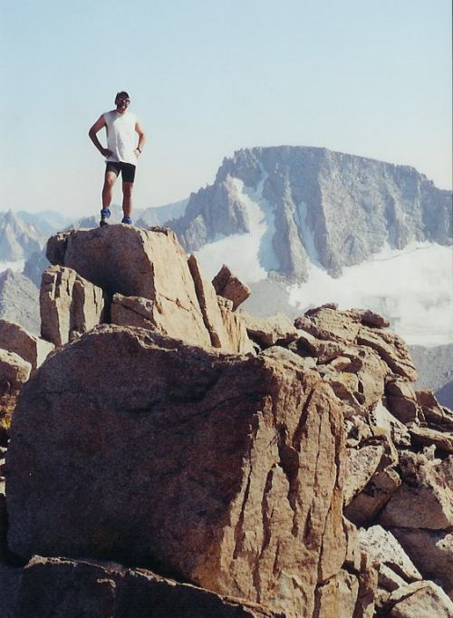 Schmed atop Mt. Lamarck with Mt. Darwin behind him.