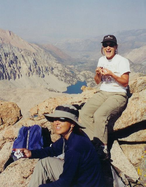 Leslie and Kirsten celebrate on the summit of Mt. Lamarck with Darwin Canyon in the background.