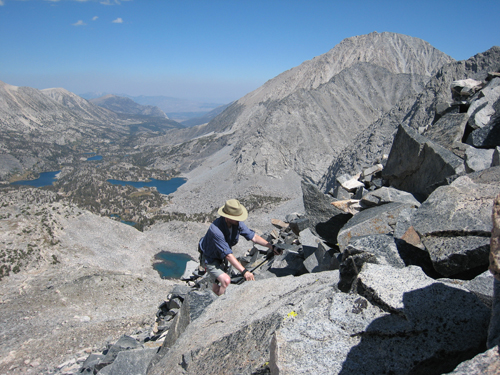 Grant Glouser climbs Pyramid Peak